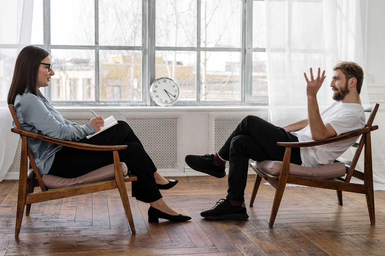 therapist discussing relationship issues and emotional abuse