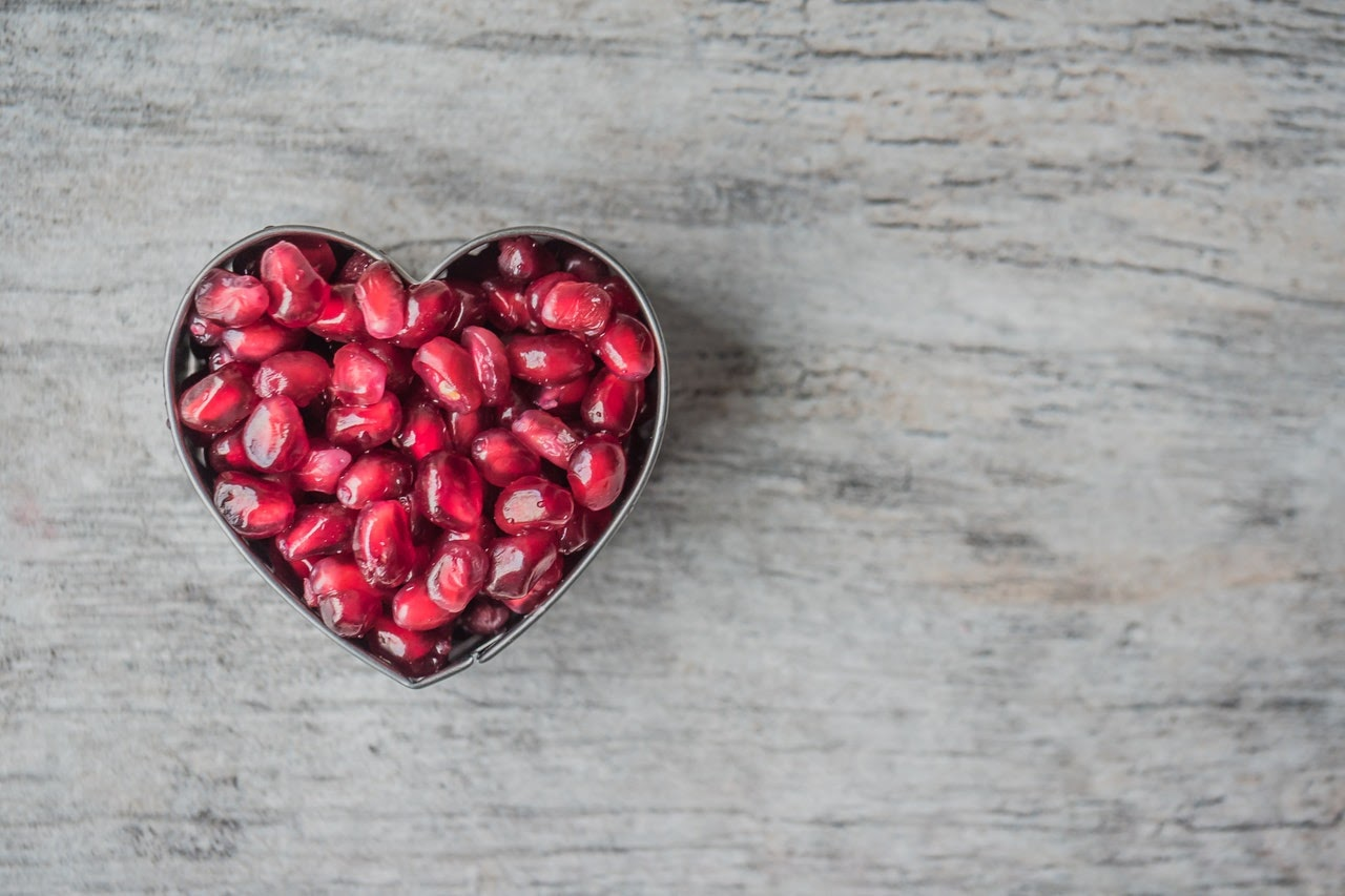 heart with pomegranate seeds