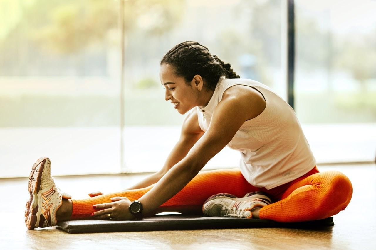 woman stretching in dance floor room