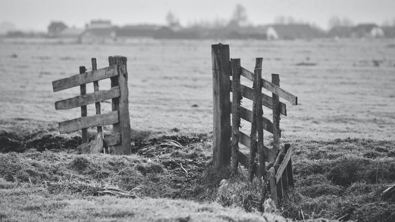 black and white broken fence