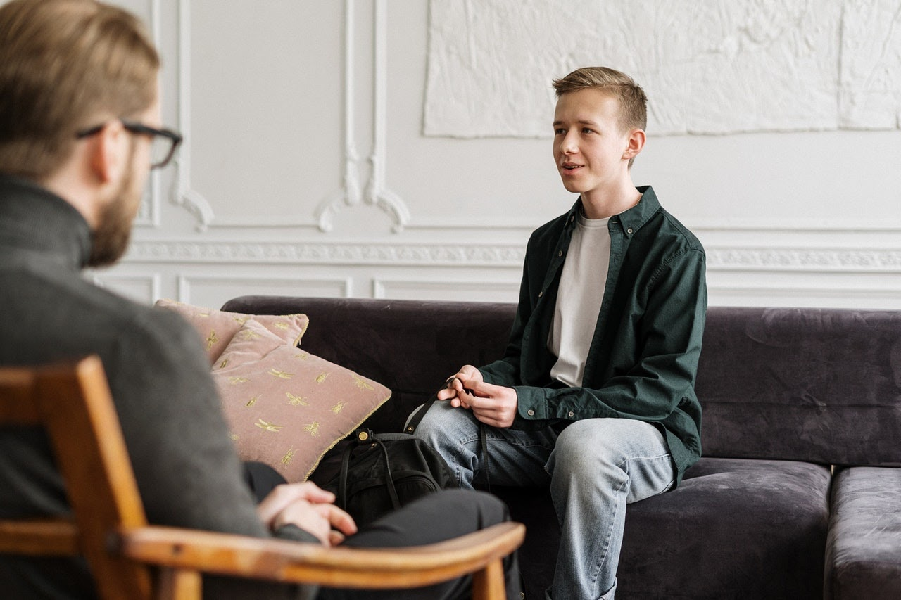 Boy talking to therapist