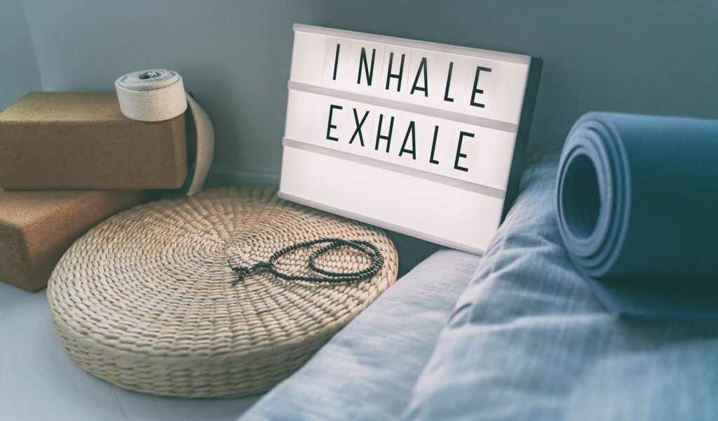 inhale exhale sign with yoga mat