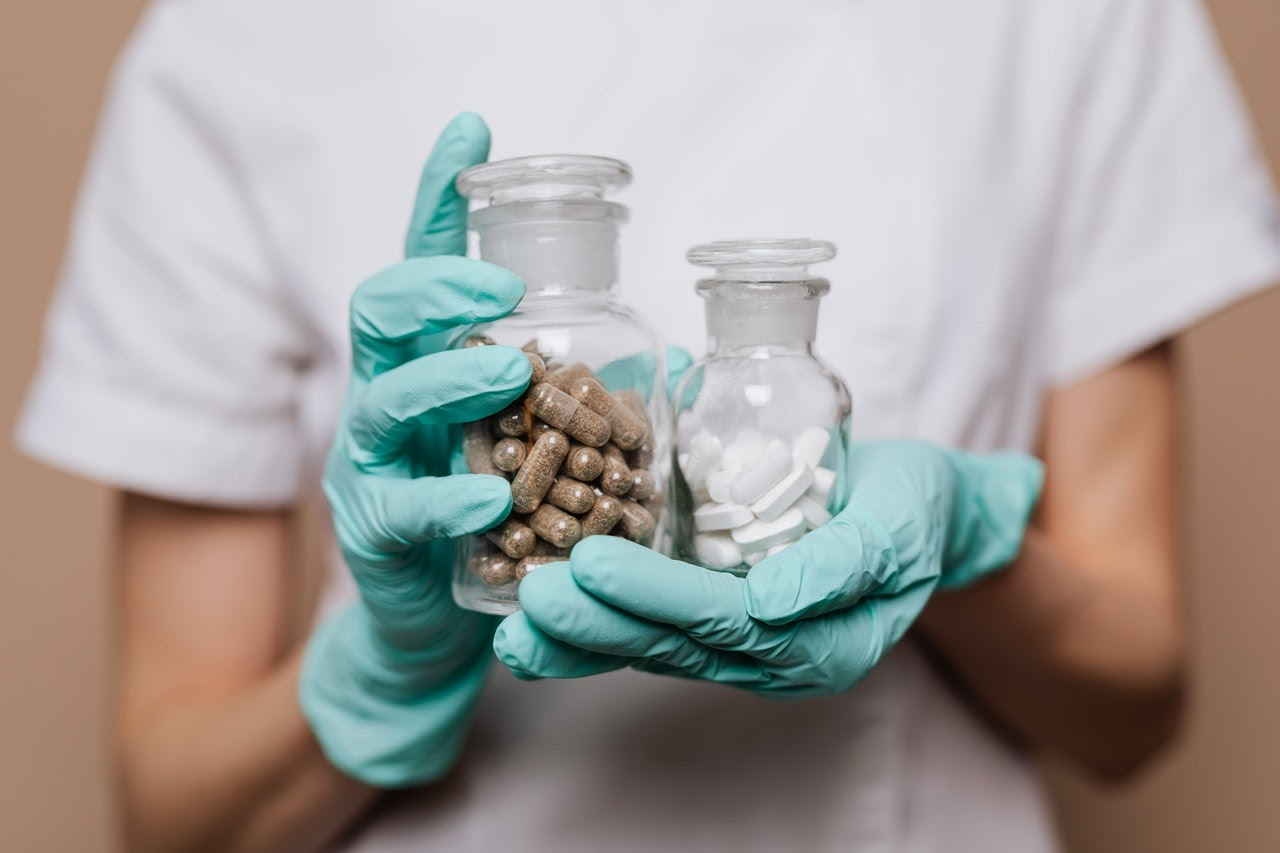 person holding medication for questions to ask a therapist